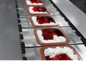 Non-contact infrared temperature sensors with peak or valley hold can be used to measure the temperature of individual food products on a conveyor.